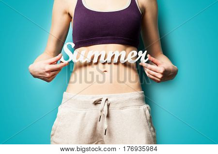 Photo Of Perfect Slim Female Body With Tablet  In The Hands On The Wonderful Blue Background