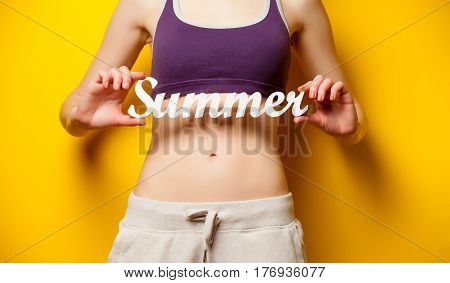 Photo Of Perfect Slim Female Body With Tablet  In The Hands On The Wonderful Yellow Background