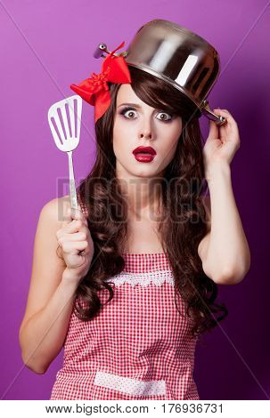 Photo Of Beautiful Young Woman With Pan On The Head On The Wonderful Purple Background