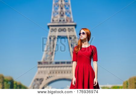 Beautiful Young Woman On The Eiffel Tower Background