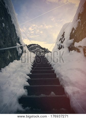 photo of the stairs in the winter on the wonderful mountains background