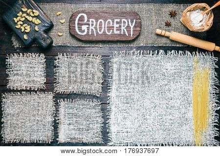 Rustic style template for food and drink industry. Burlap frames on dark wood background with flour pack and pasta. Wooden board with text 'Grocery' as title bar