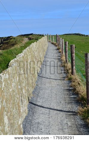 Hiking trail along the sea cliffs of Moher in Ireland.