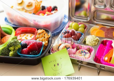 Mom packs a happy note of encouragement with a colorful Bento box lunch packed with healthy fruits veggies and snacks
