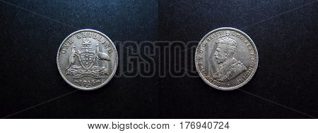 The Reverse and the Obverse view of the 1916 0ne Shilling Vintage Silver Coin 1916. with King George V and the Australian Coat of Arms. KW coins shilling silver money cash change currency pre-decimal coinage dosh numismatics coins australian coins collect