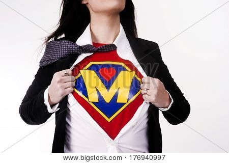 Woman wears a superhero style t-shirt under her business suit