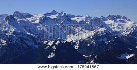 Uri Rotstock and other mountains seen from mount Fronalpstock Switzerland.