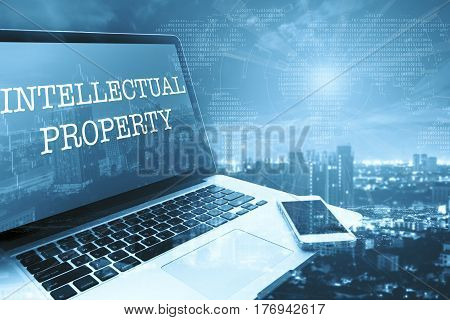 INTELLECTUAL PROPERTY: Grey computer monitor screen. Digital Business and Technology Concept.