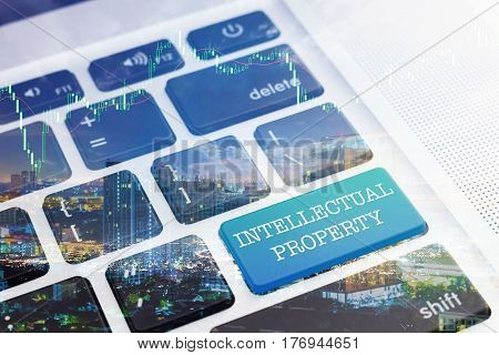 INTELLECTUAL PROPERTY: Green button keyboard computer. Double Exposure Effects. Digital Business and Technology Concept.
