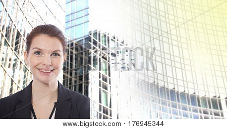 Young businesswoman in front of blurred office building background