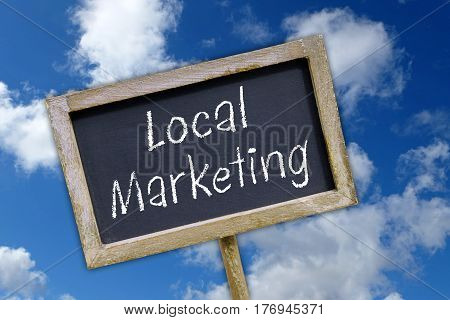 Local Marketing - chalkboard with text on blue sky background