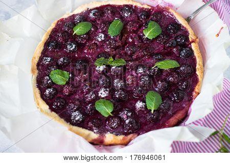 Sweet cherry cake pie tart. Summer dessert. Top view. Grey Concrete table