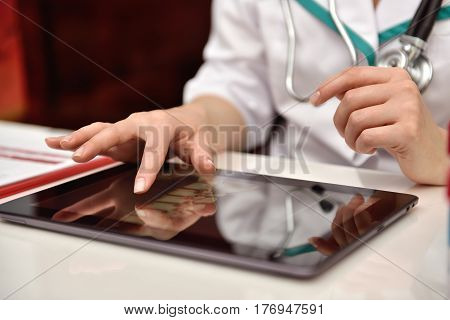Woman Examines An X-ray Of Patient