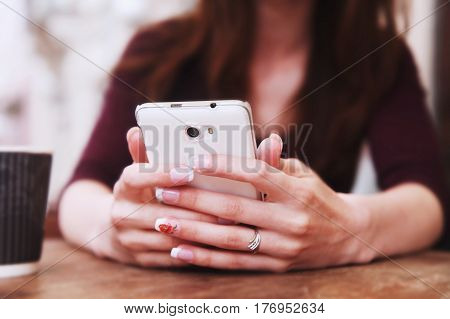 Social Media addiction. young beautiful woman holding a smartphone (psychological problems media mania concept)