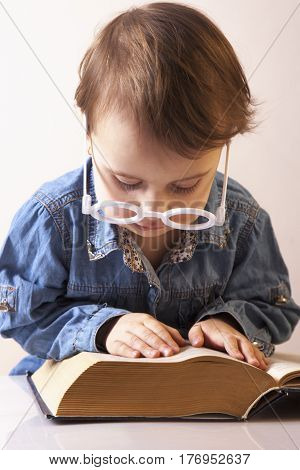 Professor reading a book. (Humorous picture). Science knowledge teaching success self development concept.