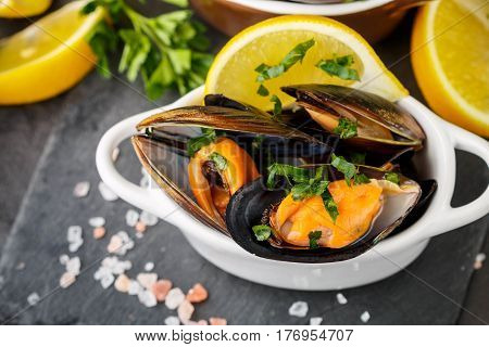 Mussels In Wine With Parsley And Lemon. Seafood. Clams In The Shells. Delicious Snack For Gourmands.