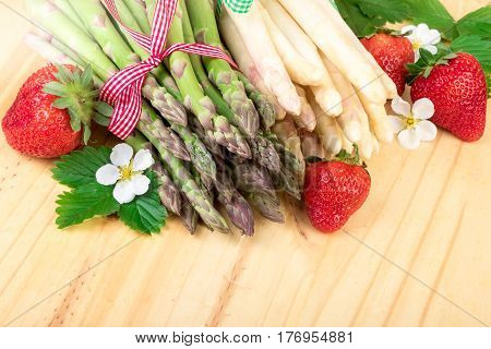 Asparagus. Fresh green and white asparagus with strawberries retro decoration