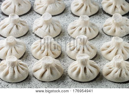 Khinkali Is The National Dish Of Georgian Cuisine. Products Meat And Dough With Spices. Selective Fo