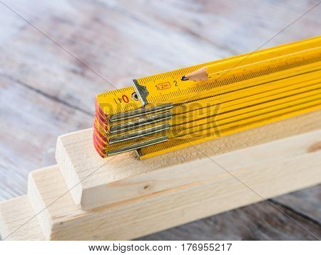 Wooden Materials And Measuring Meter Yellow Pencil