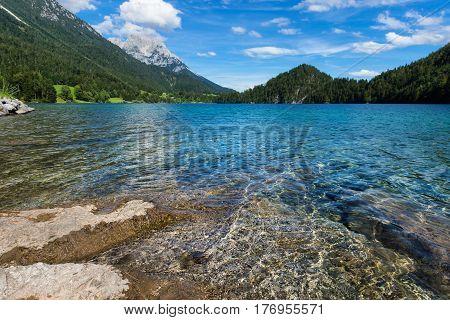 Mountain lake with clear water. Austria Tirol Hintersteiner Lake Wilder Kaiser Nature Reserve