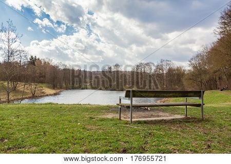 Relaxing Park Bench View Over Water Forest Landscape Peaceful Tranquil Sunny Sky