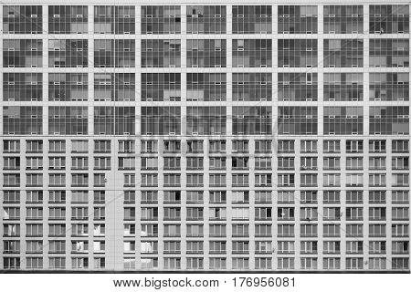 Texture of facade of contemporary residential or business skyscraper building with multiple regular windows in Moscow Russia frontal view