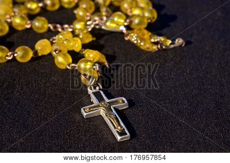 rosary on blackground with free space for text