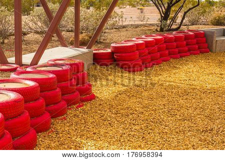 Red Rubber Tires At Children's Playground Used For Buffer & Bumpers For Kits