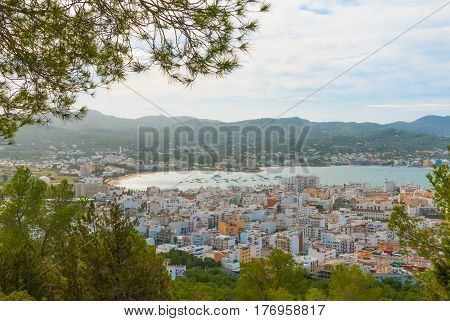 Hillside views of St Antoni de Portmany, Ibiza, on a clearing day in November, kindly warm breeze in autumn,  Balearic Islands, Spain.