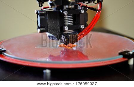 Modern 3D printer printing figure close-up macro. Automatic three dimensional 3d printer performs plastic modeling in laboratory. 3d-printing processing with white background