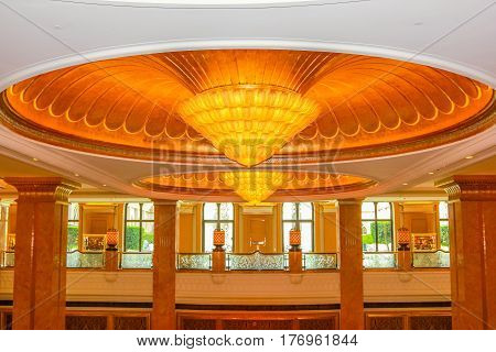 Abu Dhabi, United Arab Emirates - April 21, 2013: interior of Emirates Palace, luxurious hotel and landmark of Abi Dhabi. Decorations with gold, marble and Swarovski. Luxury travel concept.