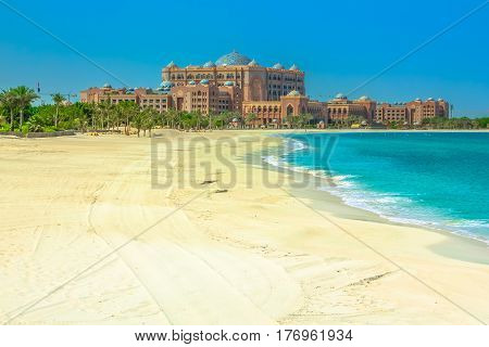 Abu Dhabi, United Arab Emirates - April 21, 2013: Emirates Palace Hotel white pristine beach, a luxurious hotel with its own marina and helipad. Summer holidays concept. Luxury and comfort lifestyle.
