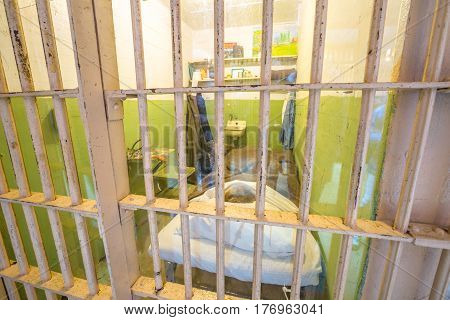San Francisco, California, United States - August 14, 2016: detail inside Alcatraz famous cell of character painter Doc, from Clint Eastwood movie: Escape from Alcatraz in 1989.