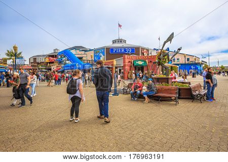 San Francisco, California, United States - August 14, 2016: tourist at Fisherman's Wharf.Aquarium of the Bay, a popular attraction, between Embarcadero and Pier 39.Leisure, holidays and travel concept