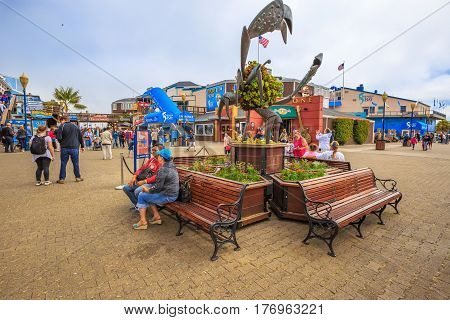 San Francisco, California, United States - August 14, 2016: people in front of Aquarium of the Bay, a popular tourist attraction, between Embarcadero and Pier 39. Leisure, holidays and travel concept.