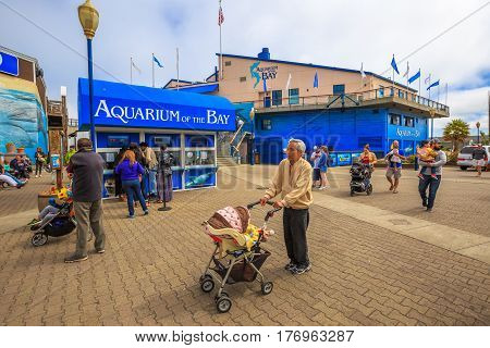 San Francisco, California, United States - August 14, 2016: tourists buy tickets for Aquarium of the Bay, a popular attraction, between Embarcadero and Pier 39. Leisure, holidays and travel concept.