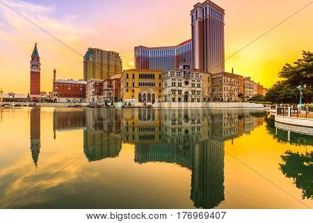 Macau, China - December 9, 2016: Venetian Casino and Tower, luxury outlets, mirroring on the artificial lake at sunset. The Venetian Macao is modeled on its sister casino resort The Venetian Las Vegas.