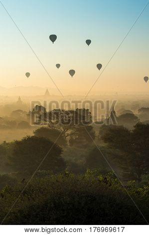 Hot air balloons fly over ancient pagodas in Bagan Mandalay region Myanmar (Burmar). Most popular destination in southeast asia.