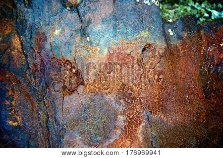 Abstract blue and red swirls of rust