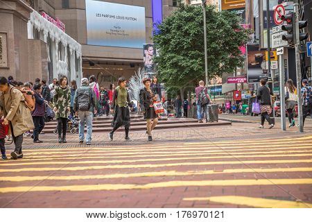 Hong Kong, China - December 6, 2016: the crowded Times Square, with different people walking and shopping, in the largest shopping mall in Causeway Bay, the luxury shopping district.