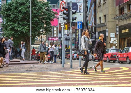 Hong Kong, China - December 6, 2016: Causeway Bay is one of the most attractive areas for tourists and business people and best for shopping. Asian busy people crossing the Times Square intersection.