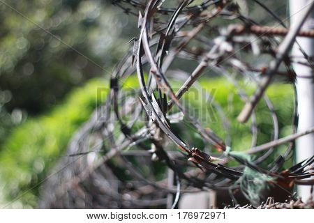 wire barbed fence hard steel iron metal for security in prison or barrier security around building photo