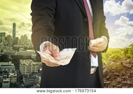 scene of busineesman give the money to you on half side background - can use to display or montage on product or corruption concept