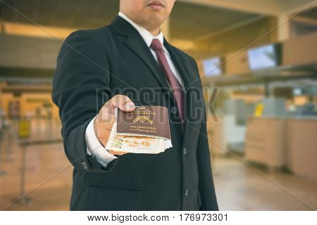 abstract vintage filter on businessman give a passport for immigration for vacation - can use to display or montage on product