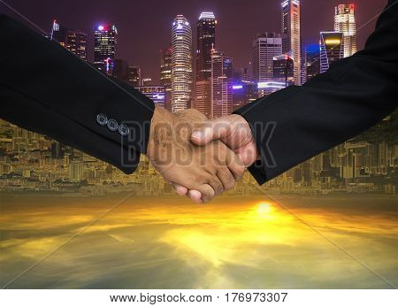 double side of cityscape background for commitment hand shake in business concept - can use to display or montage on product