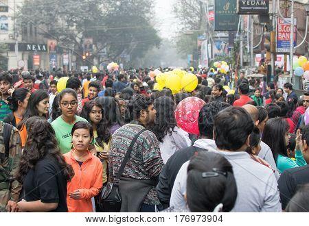 KOLKATA WEST BENGAL INDIA - JANUARY 17TH 2016 : City children enjoying on blocked otherwise busy Park Street for