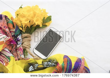 colorful bouquet flowers with mobile on background white in concept yellow mellow