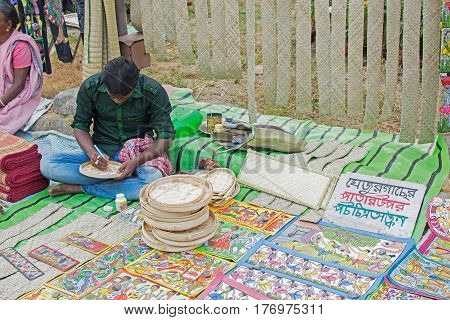 Kolkata West Bengal India - 28th November 2015 : Pattachitra traditional painting on leaves of date-palm handicrafts on display during the Handicraft Fair in Kolkata. It is the biggest handicrafts fair in Asia.