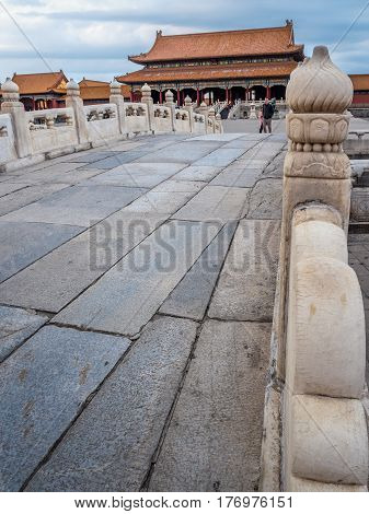 Beijing, China - Oct 30, 2016: On the marble balustrades of the Inner Golden River Bridges. Ahead is the Gate of Supreme Harmony (Taihemen), Forbidden City (Gu Gong, Palace Museum). Vertical afternoon view.