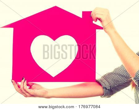 Happy Woman Holding Pink Paper House